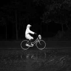 Man riding bicycle in the dark