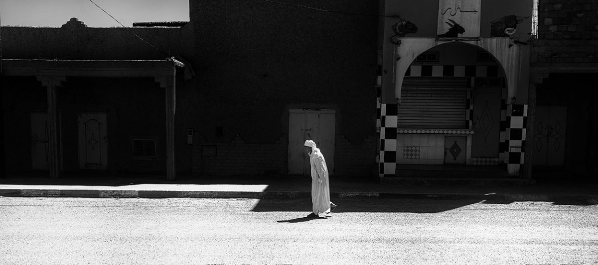 Street photography of a walking man in Morocco