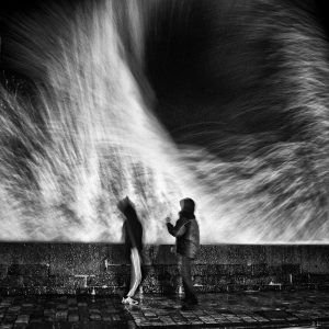 Two man playing with waves