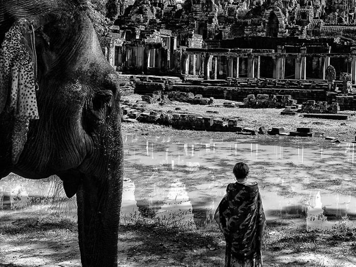 Elephant and woman in Bayon temple